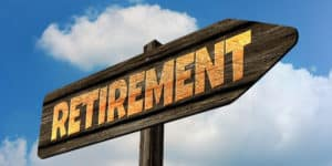 Road sign pointing toward retirement