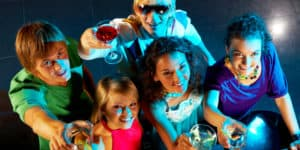 Overhead view of a group of young people raising their glasses at a party